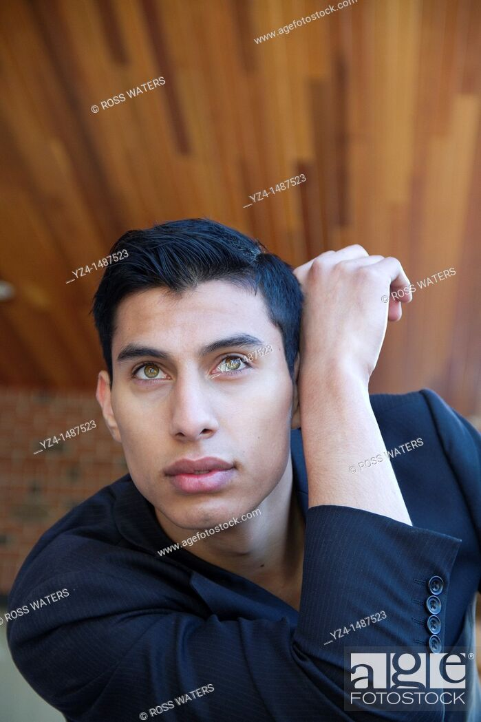 Stock Photo: Hispanic young male posing at park.