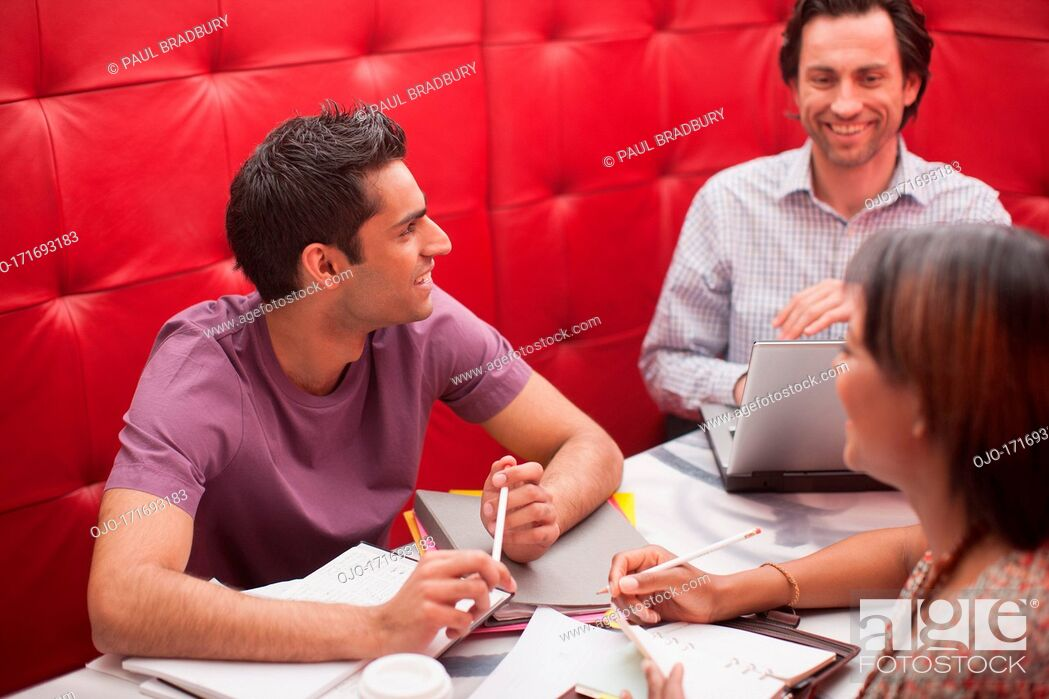 Stock Photo: Smiling business people in meeting.