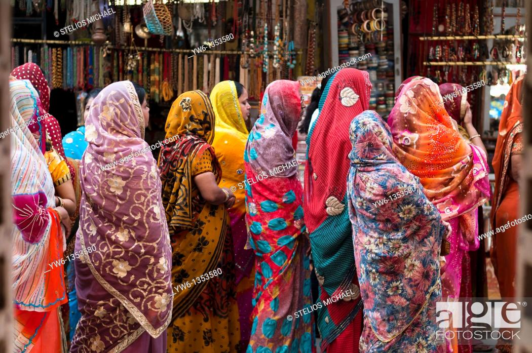 Stock Photo: Women in colourful saris during a religous festival in Pushkar, Rajasthan.