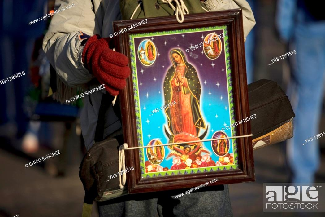Stock Photo: A pilgrim carries an image of the Our Lady of Guadalupe outside of the Our Lady of Guadalupe Basilica in Mexico City, December 11.