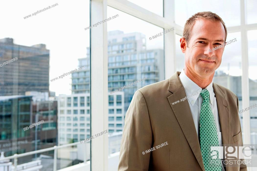 Stock Photo: Businessman in office, portrait.