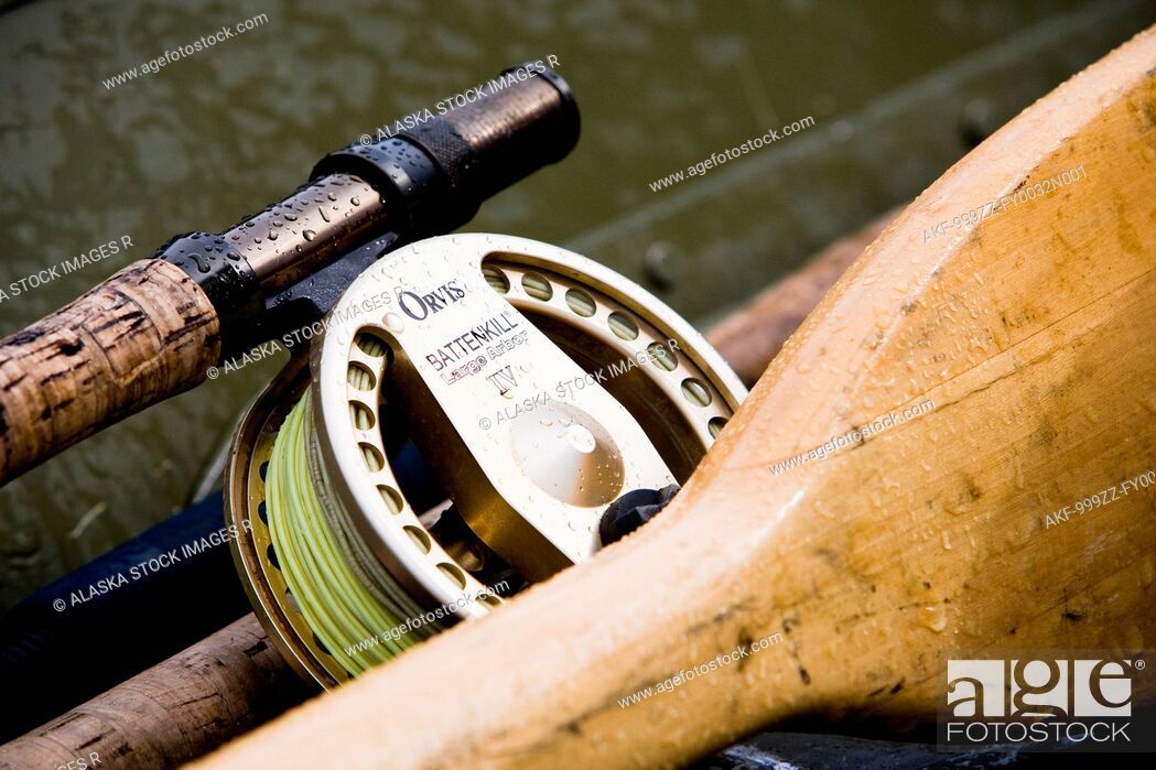Stock Photo: Digitally Altered, Close up of a Fly fishing reel, rod and oars laying in a skif, Southwest Alaska, Summer.