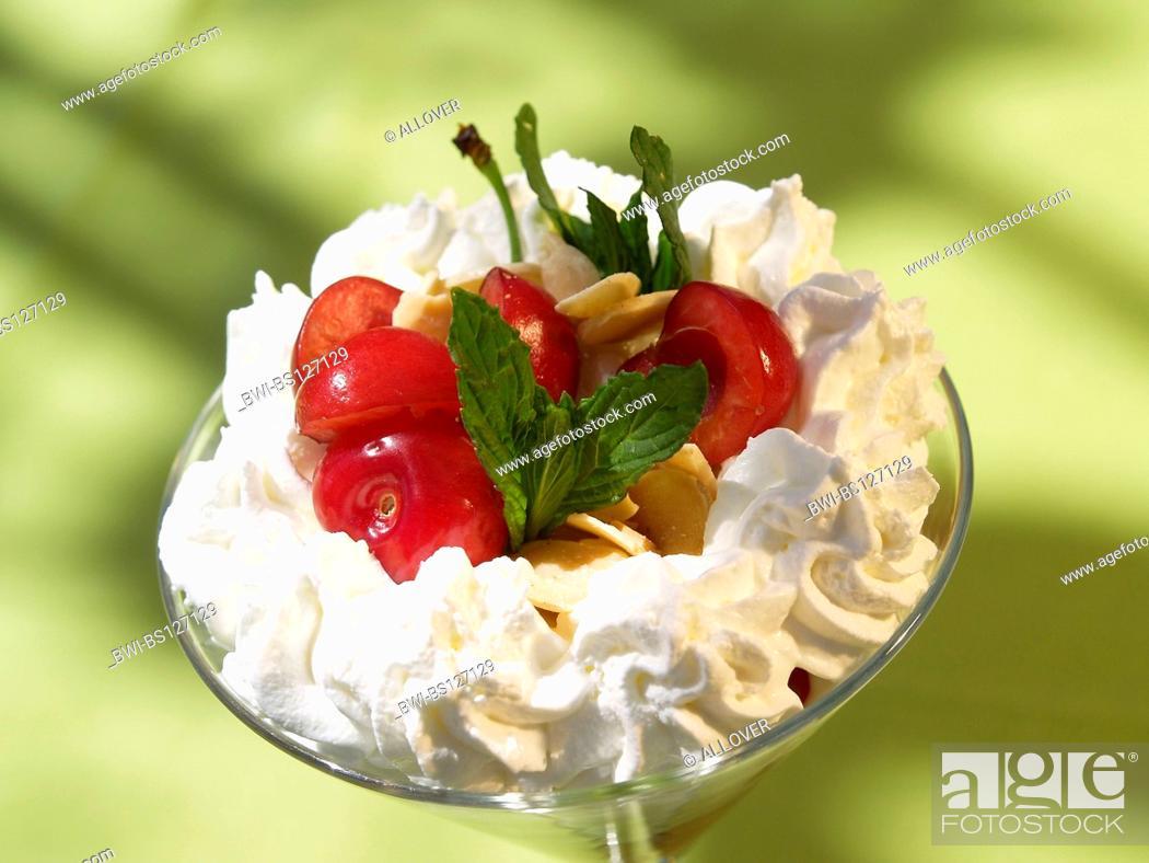 Stock Photo: dessert cherries whipped cream.