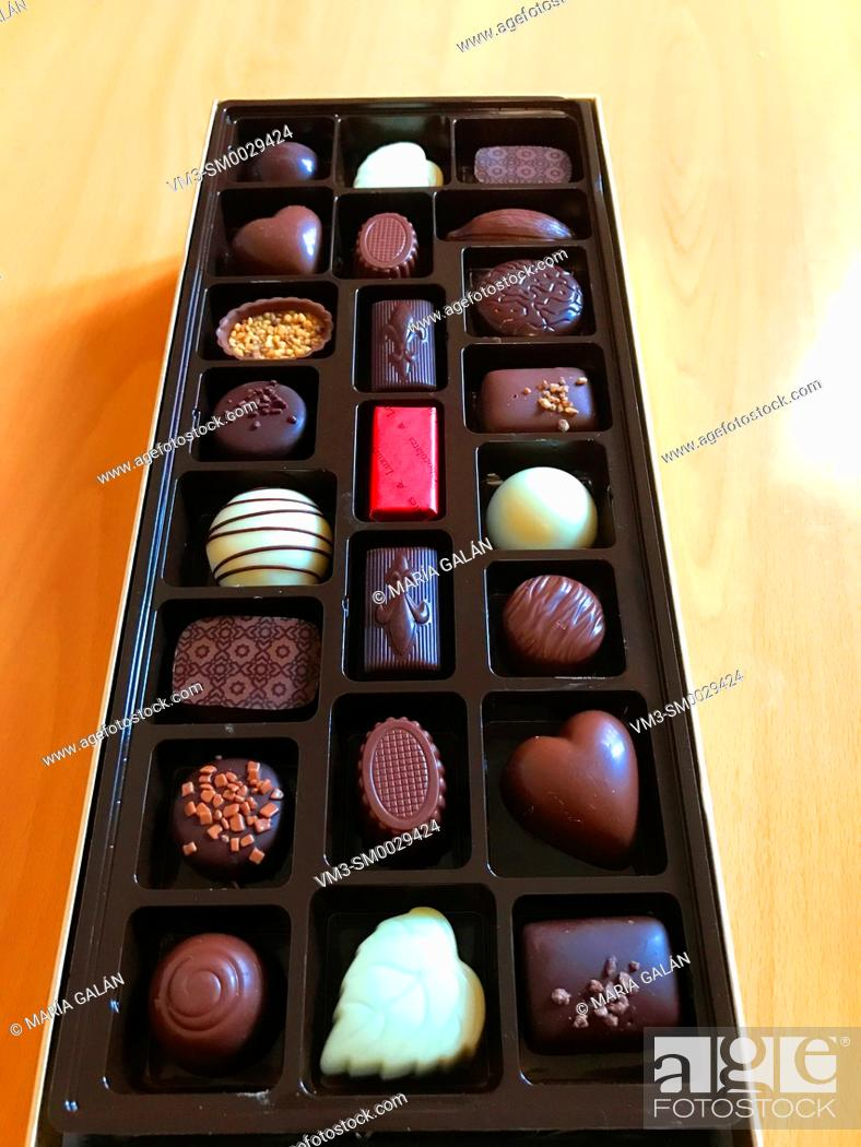 Stock Photo: Assorted chocolates in container.