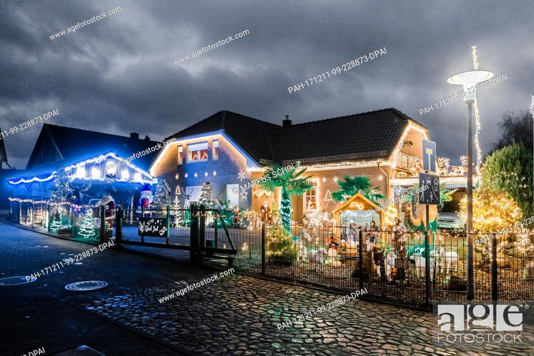 Stock Photo: The house of the Rahlfs family shines in the night with hundreds of lights and Christmas figures in Barnitz, Germany, 5 December 2017.