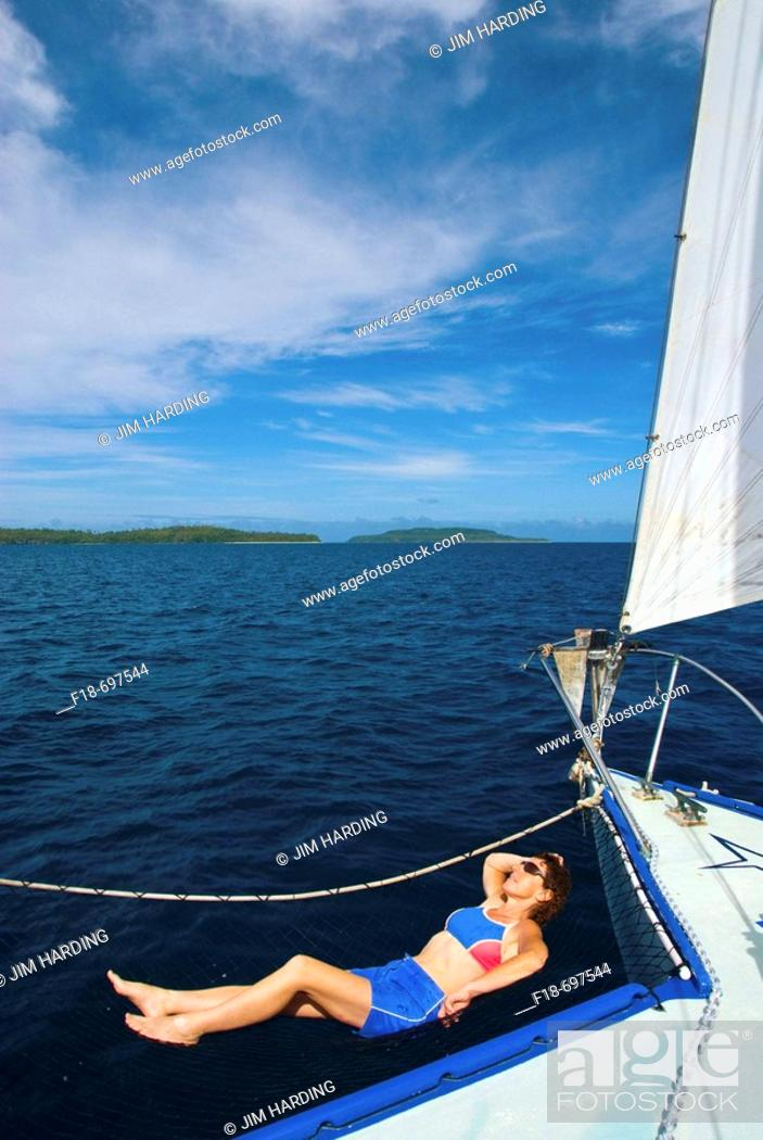 Stock Photo: Holiday maker relaxing on sailing charter vessel, Vava'u, Kingdom of Tonga, South Pacific.
