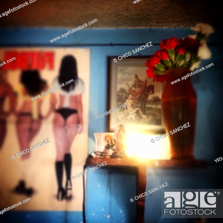 Imagen: An altar to Saint Martin Caballero and a picture of women in underwear decorate a home in Colonia Roma, Mexico City, Mexico.