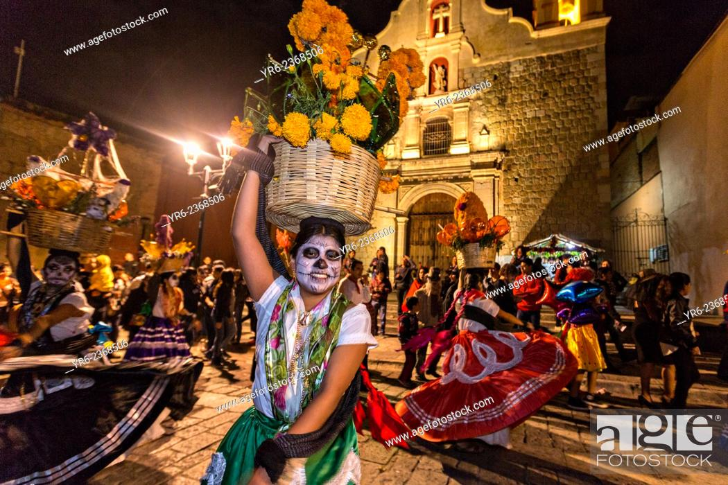 Stock Photo: Costumed dancers at a Comparsa, or parade during the Day of the Dead Festival known in spanish as D'a de Muertos on October 31, 2014 in Oaxaca, Mexico.