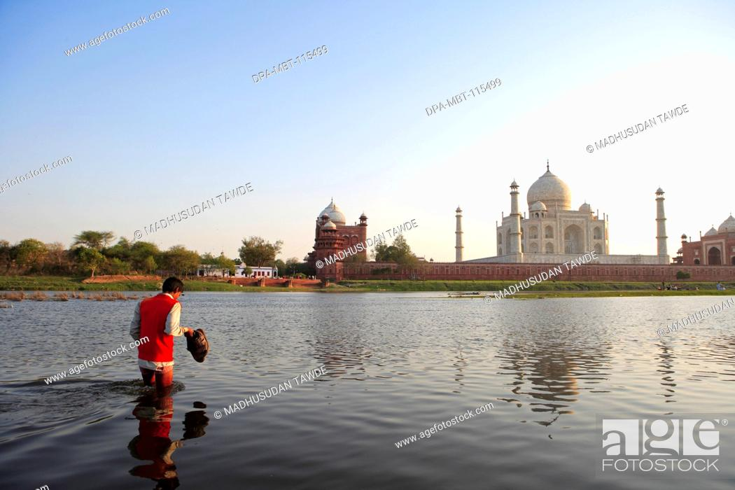 Stock Photo: Man crossing river Yamuna at Taj Mahal Seventh Wonders of World , Agra , Uttar Pradesh , India UNESCO World Heritage Site.