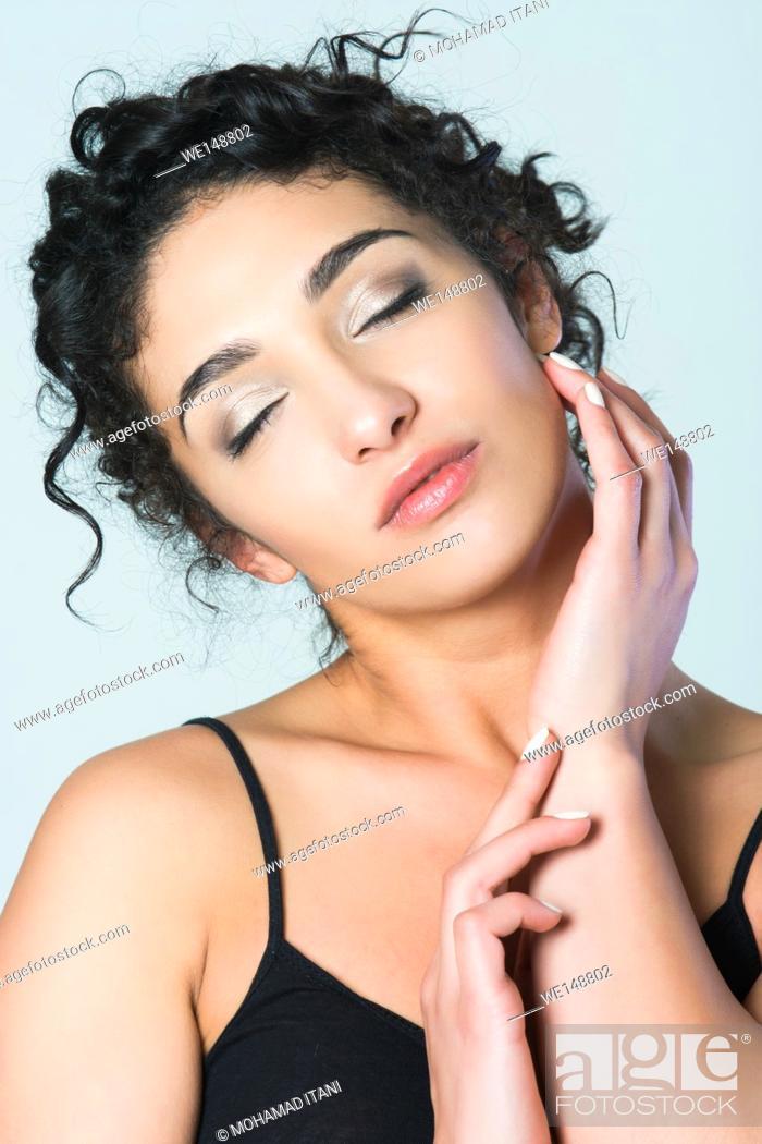 Stock Photo: Beautiful young woman hand feeling skin.
