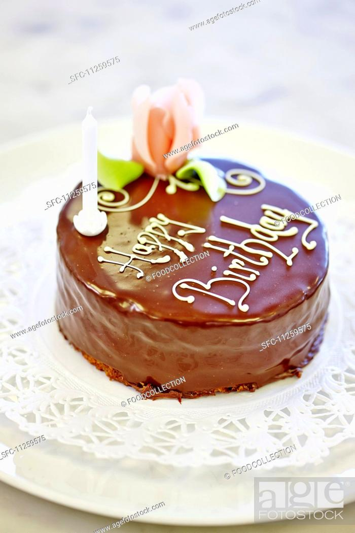 A Birthday Cake Decorated With Chocolate Glaze And A Marzipan Rose