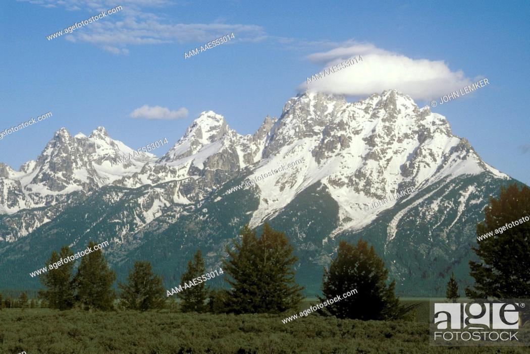 Stock Photo: Cloud over the Grand Teton Grand Tetons WY Wyoming.