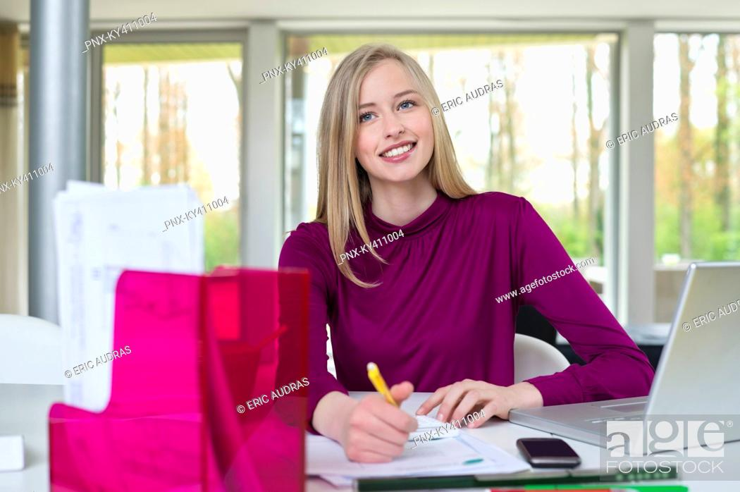 Stock Photo: Happy businesswoman working in home office.