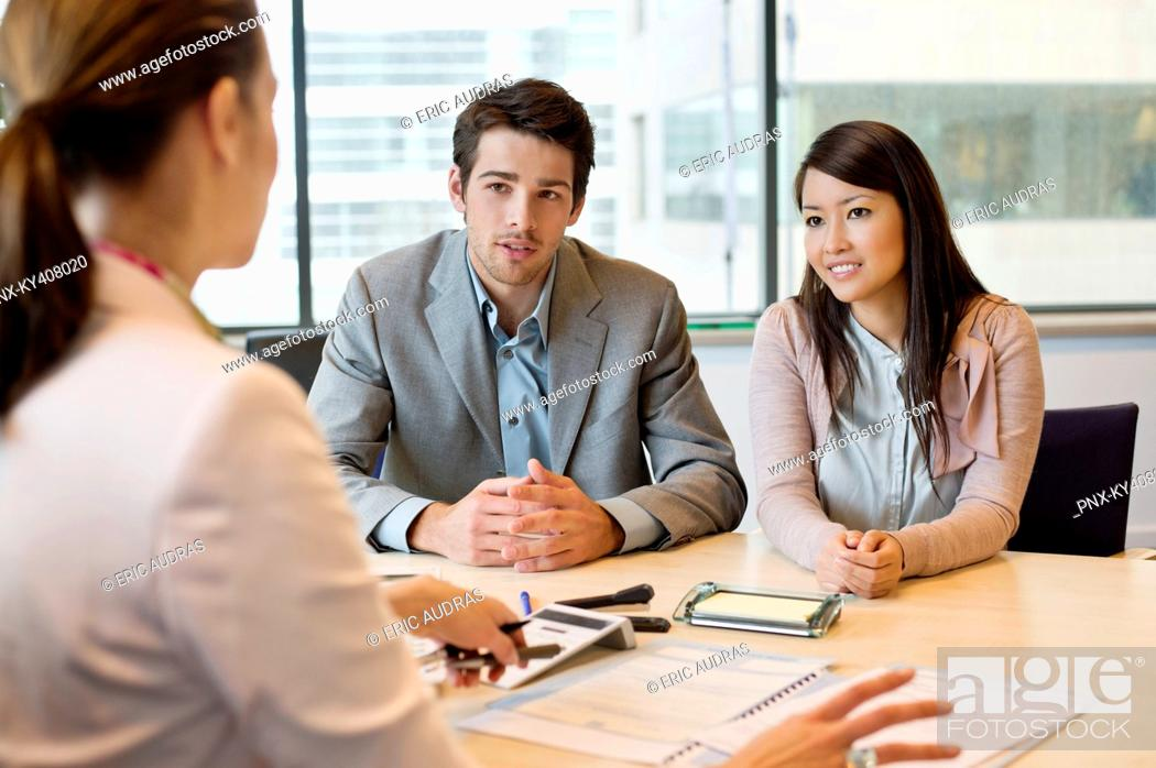 Stock Photo: Business executive discussing with her clients.