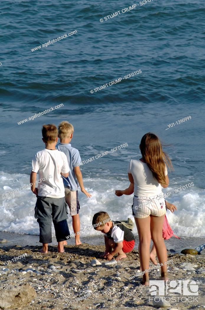 Stock Photo: Children play on the beach, Marbella, Costa Del Sol, Andalucia, Spain, Europe.