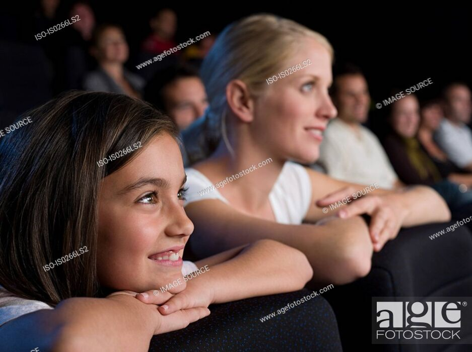 Stock Photo: Mother and daughter watching a movie.