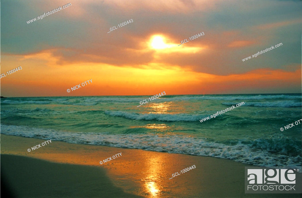 Stock Photo: Orange sky over the sea at sunset.