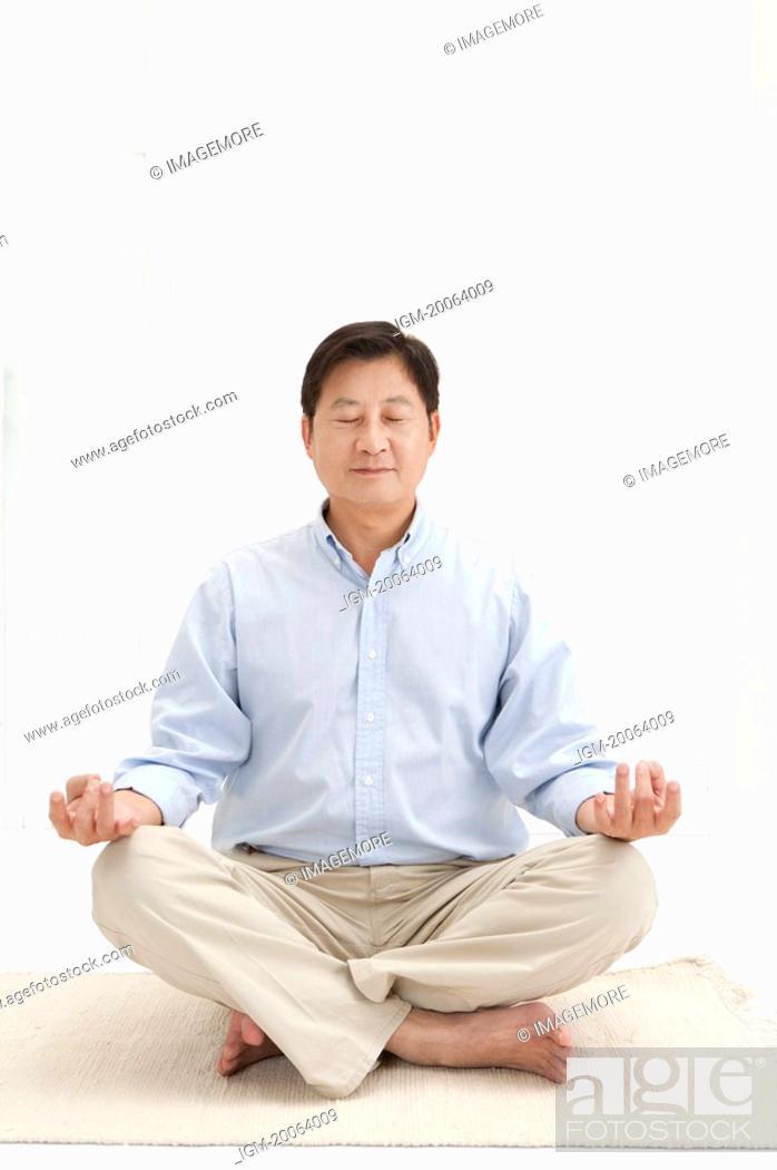 Stock Photo: Husband, Man making lotus position with eyes closed.