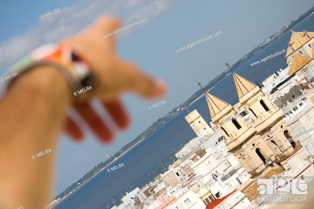 Stock Photo: Close-up of a human hand pointing to a church of San Antonio  Cadiz  Andalusia  Spain.