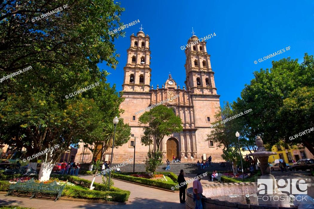 Stock Photo: Group of people in front of a church, Soberbio Templo De San Jose, Morelia, Michoacan State, Mexico.