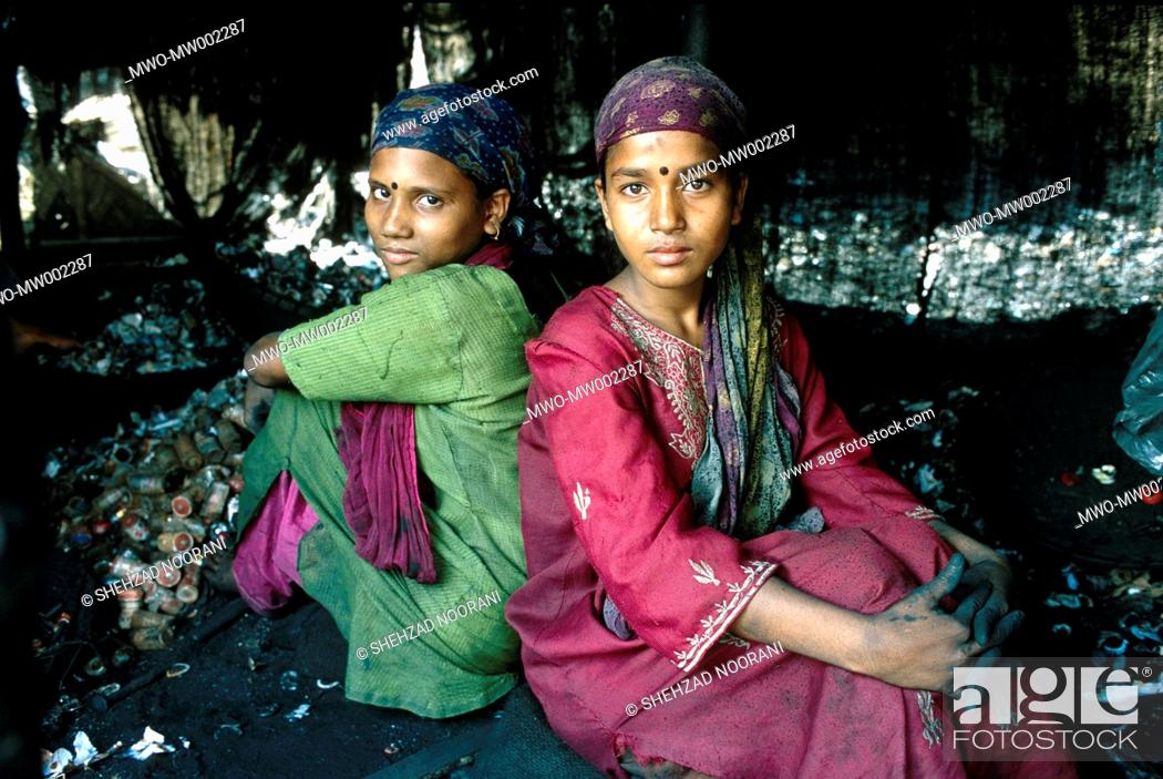 Stock Photo: Kulsum 14-year-old, in red on right sits back