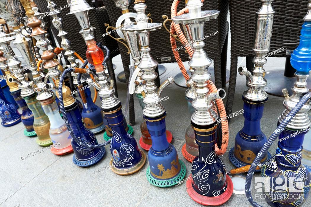 Stock Photo: Waterpipes outside a middle eastern restaurant.