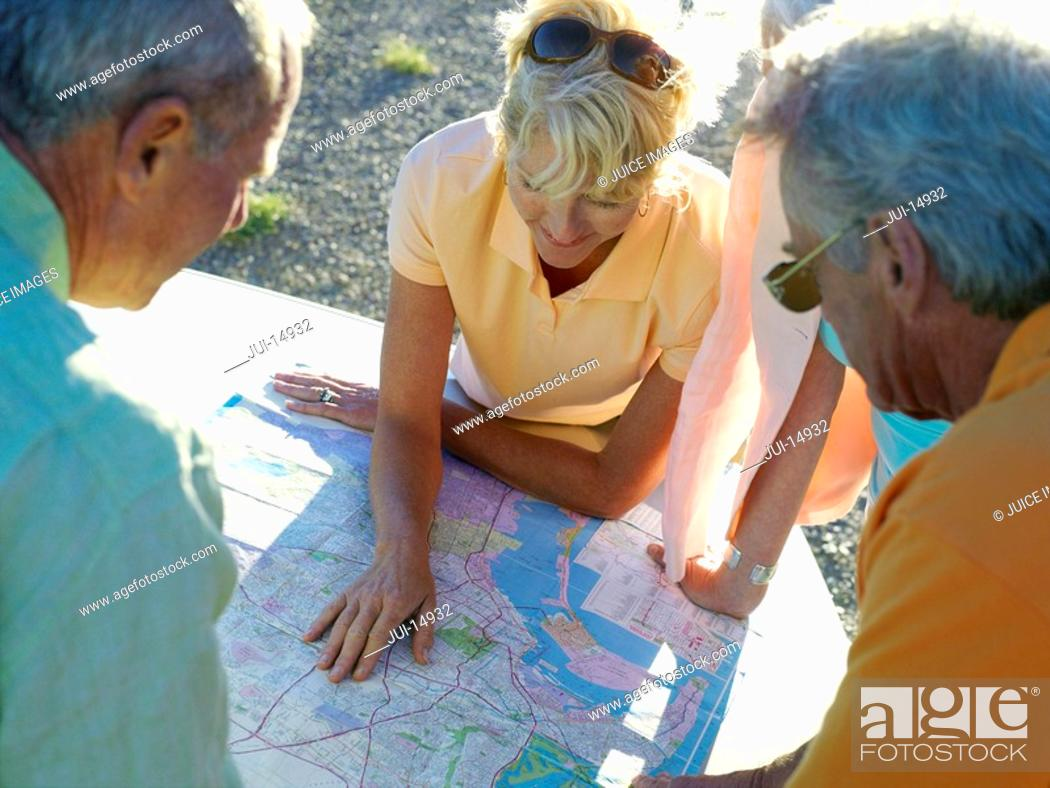 Stock Photo: Couples looking at road map, close-up.
