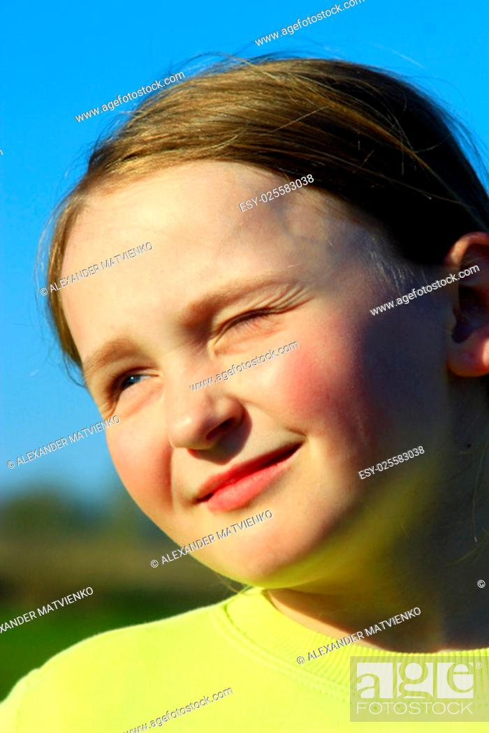 Stock Photo: portrait of little squinting girl with nice face.