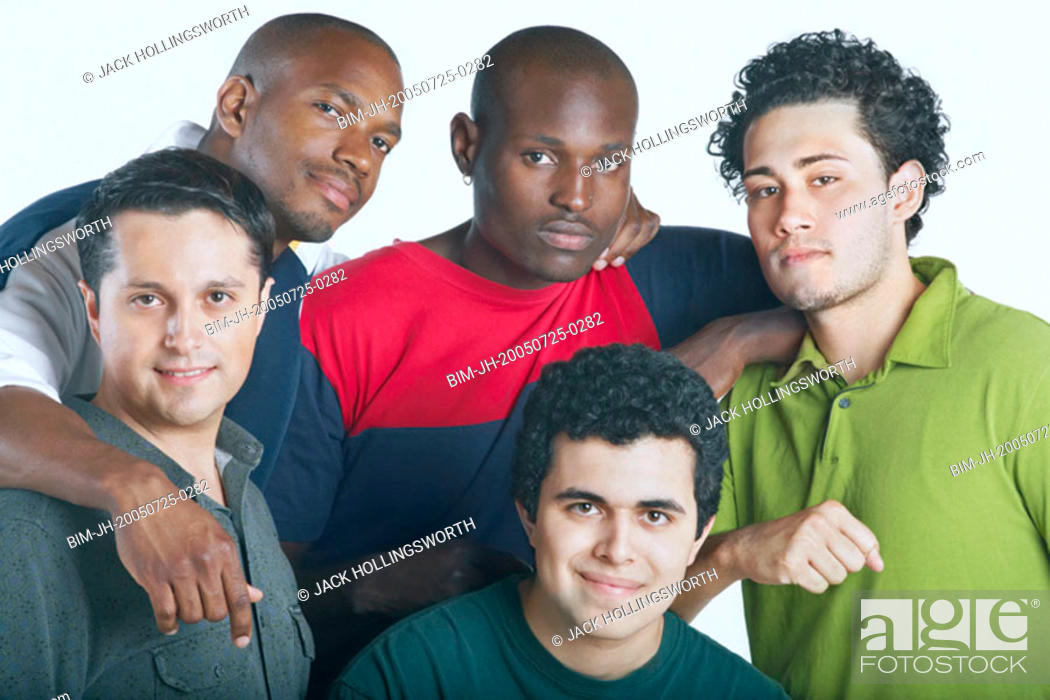 Stock Photo: Men smiling for the camera.