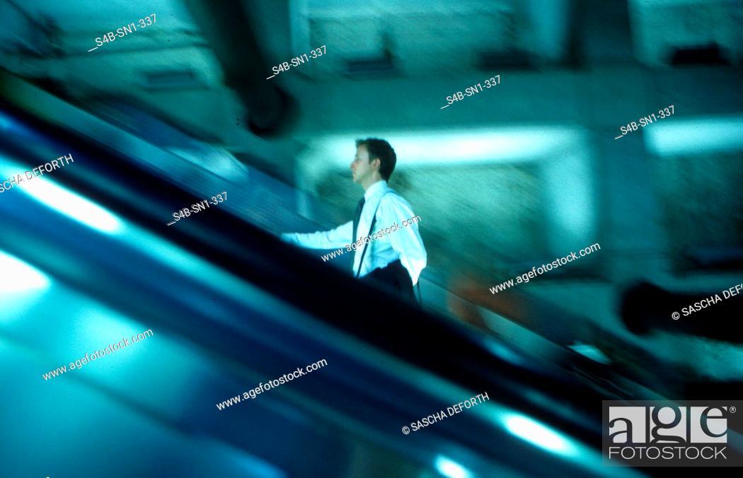 Stock Photo: Businessman on Escalator.