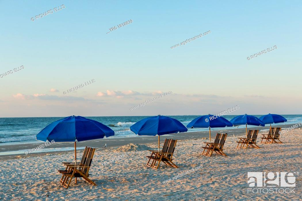 Stock Photo: Chairs and umbrellas at the beach on Hilton Head Island, SC.