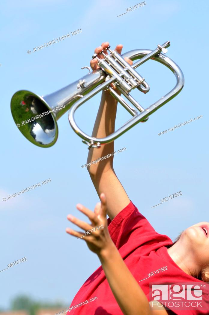 Stock Photo: Boy with a trumpet.