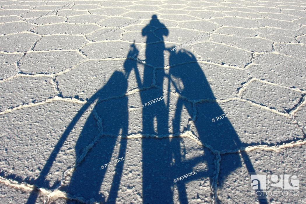 Stock Photo: Shadow of a biker on the frozen salt lake called 'Salar de Uyuni' in Bolivia.