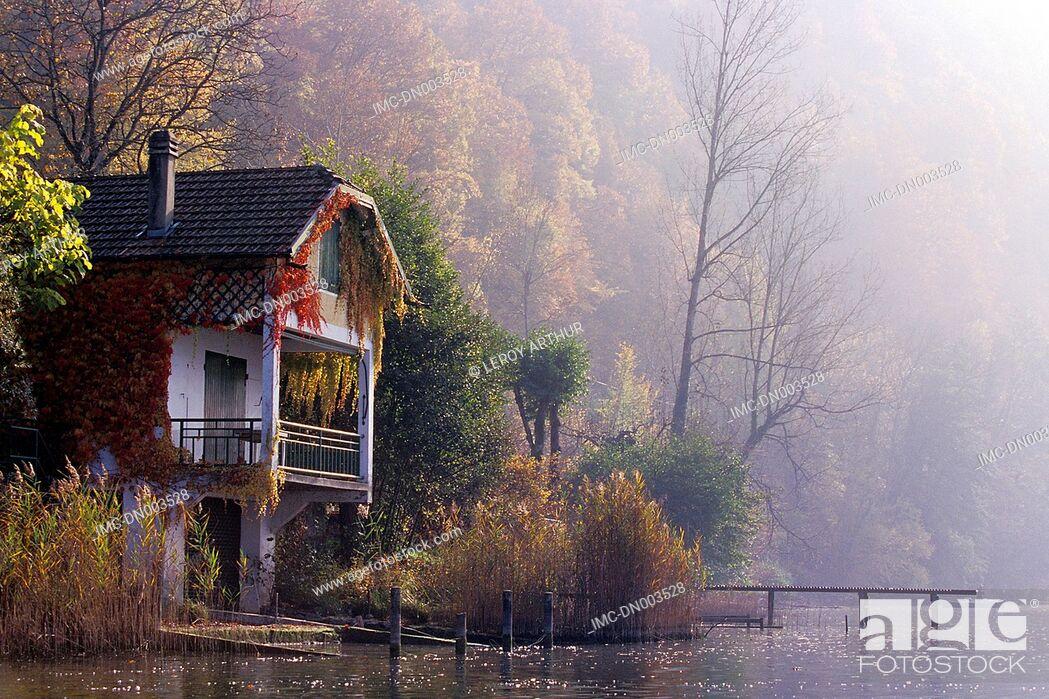 Imagen: France, Alps, Saint Alban de Montbel, lake of Aiguebelette, house in the mist.