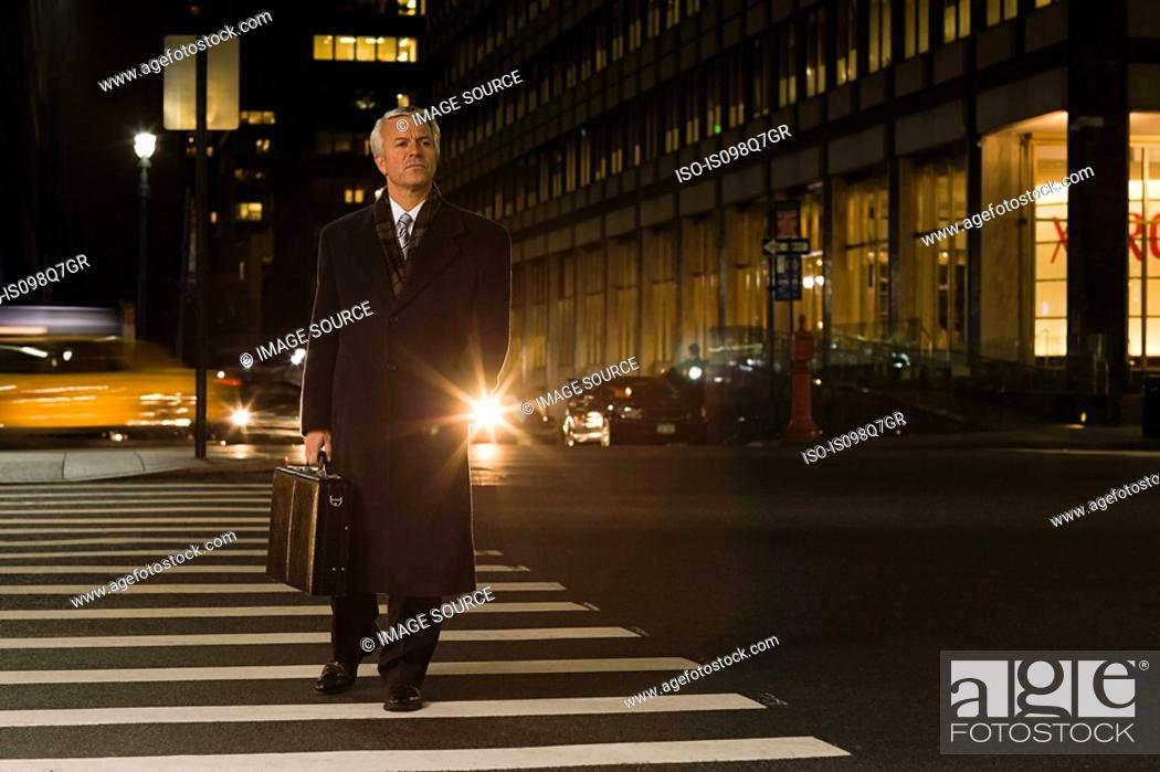Stock Photo: Businessman crossing the street.