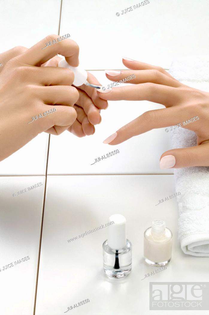 Stock Photo: Close up of woman's hand receiving manicure treatment.