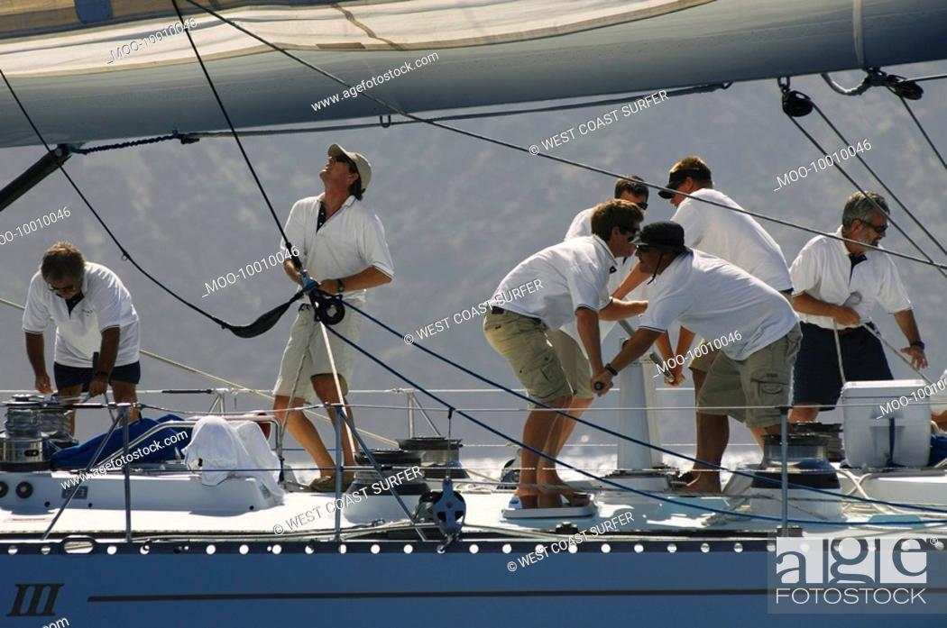 Stock Photo: Crew working on yacht side view.