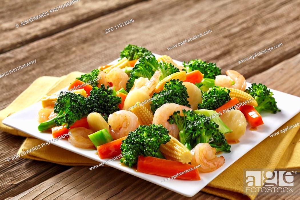 Stock Photo: Prawn stir fry with broccoli and carrots.