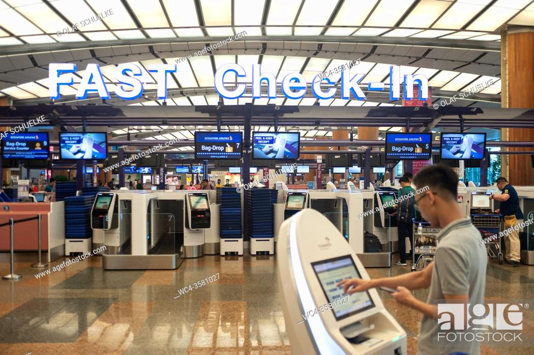 Stock Photo: Singapore, Republic of Singapore, Asia - Fast check-in area with electronic self check-in kiosks at Changi Airport Terminal 2.