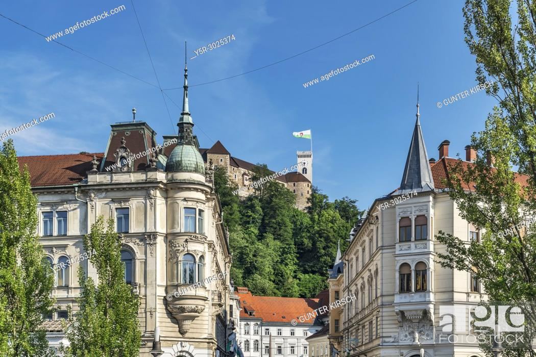 Stock Photo: View from the old town through the alley Stritarjeva ulica to the Ljubljana Castle. The Ljubljana Castle is a powerful medieval fortress and the symbol of the.