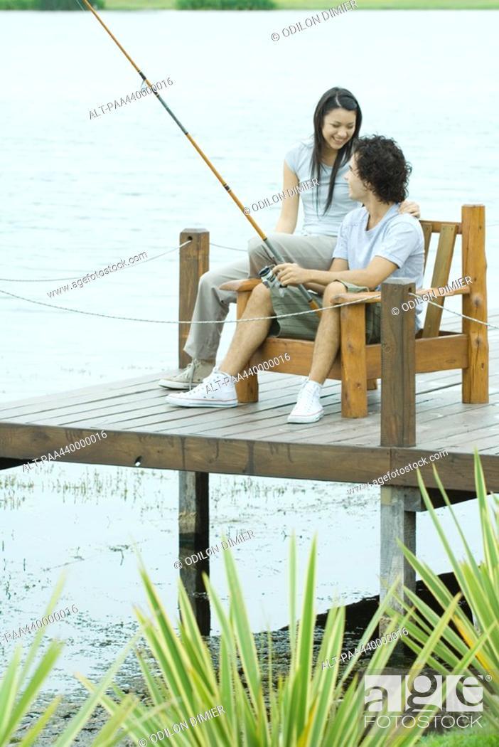 Stock Photo: Couple fishing on pier.