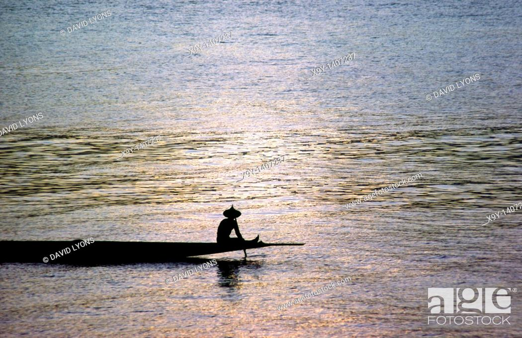 Stock Photo: River Niger in Mali, west Africa  Crossing the wide shallow Bend of the Niger at Segou by punting a long narrow piroque canoe.