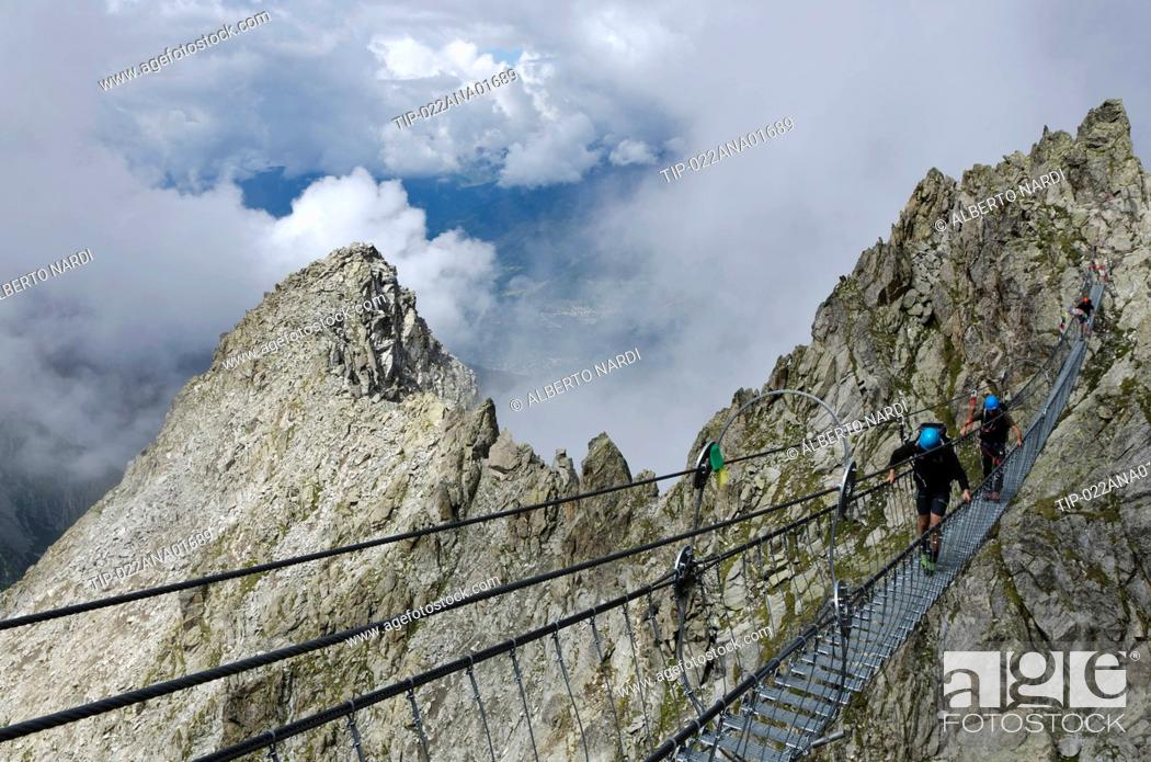Stock Photo: Italy, Retiche Alps, Lagoscuro Mountain Chain, Rope Bridge the Via Ferrata Sentiero dei Fiori.