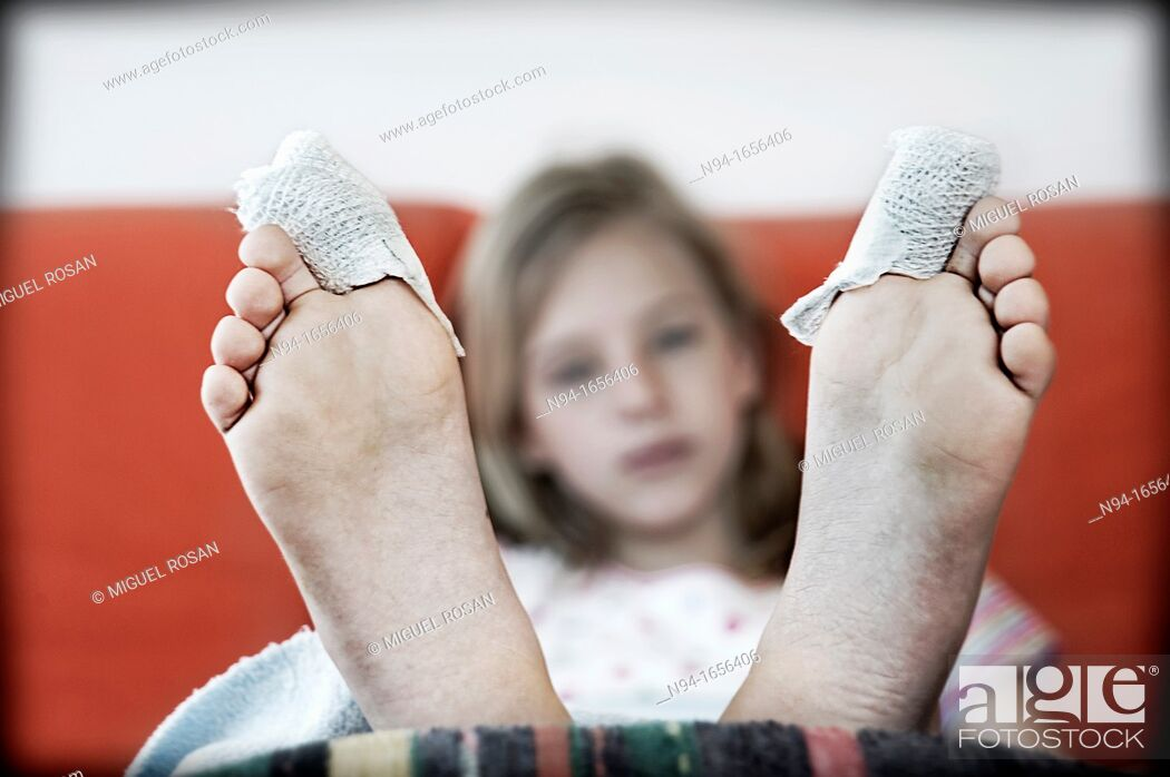 Stock Photo: Teen girl in rehabilitation after an operation on the toes.