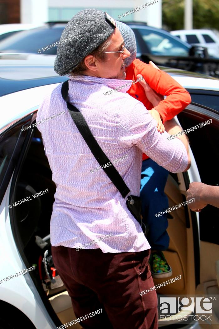 467d1c492e538 Stock Photo - Robert Downey Jr arrives at Joel Silver s Memorial Day party  with his son Exton Featuring  Robert Downey Jr ... .
