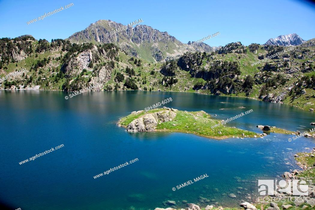 Stock Photo: Europe, Spain, Pyrenees Mountains and Lake.