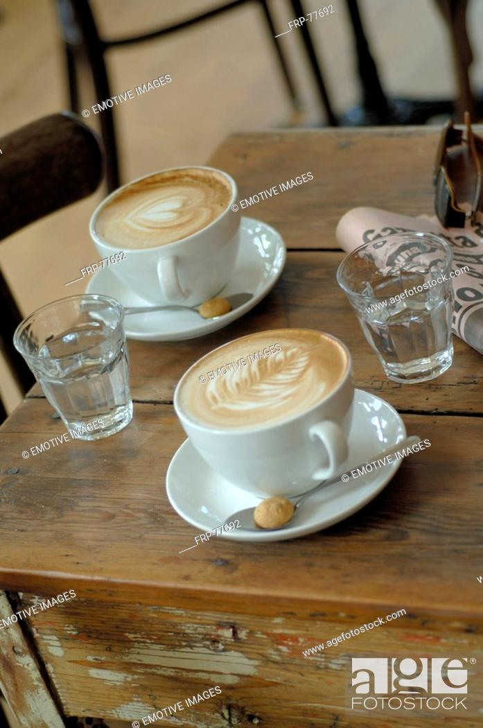 Stock Photo: Cappuccino consumption.
