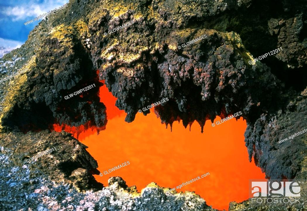 Stock Photo: Open 'skylight' reveals river of molten lava flow, Hawaii.