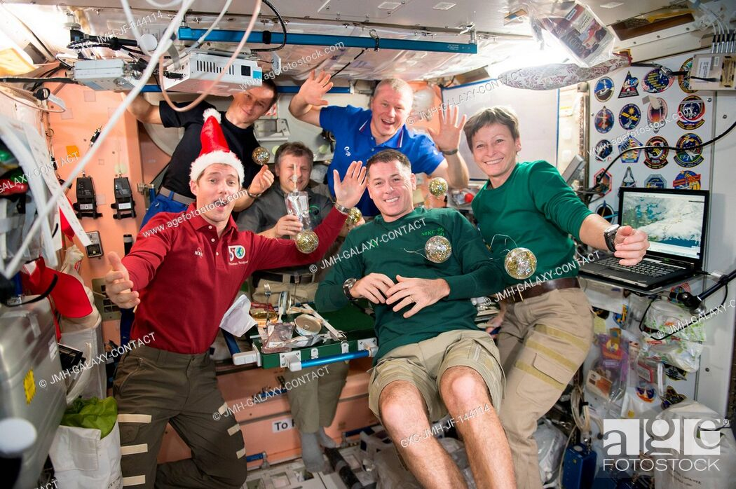 Stock Photo: The crew of Expedition 50 gathered together to celebrate the holidays aboard the International Space Station. Front row: Thomas Pesquet of ESA (left) and NASA.