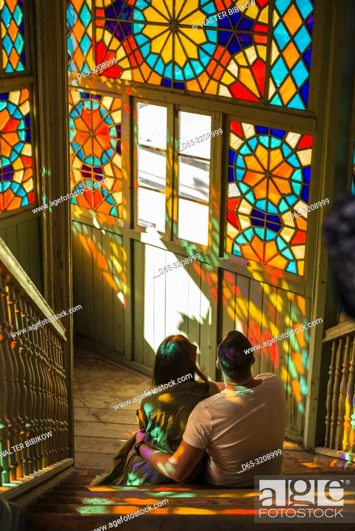 Stock Photo: Georgia, Tbilisi, Old Town, traditional Georgian building with stained-glass staircase with visitors, NR.